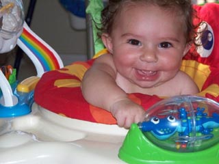 Katie loves her exersaucer!